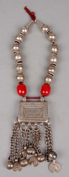 Oman | Child's amuletic necklace; silver with plastic beads, strung on cotton.  Probably from the north.  | ca. 1950s // ©British Museum. 2009,6023.228