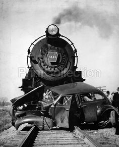 Steam Engine Train Car Crash. Newspaper press photographer's account of a horible head on train crash with an automobile. Photo probably dates to the early 1950's or perhaps as early as the 1940's.