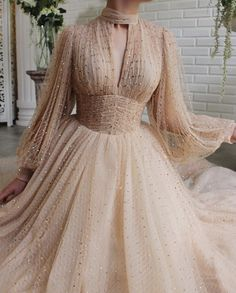 Details - Beige dress color - Crystal tulle fabric - Long sleeves with V-neck, waist definition and an open leg gown - For special occasions Glamorous Dresses, Elegant Dresses, Pretty Dresses, Beautiful Dresses, Ball Dresses, Evening Dresses, Prom Dresses, Formal Dresses, Sexy Dresses