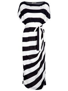 White dress from By Malene Birger featuring a bateau neck, a monochrome striped design, a ribbon belt, draping to one side, short sleeves and a curved hem.