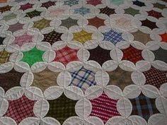 Wow!  Hand pieced and hand quilted!  864 blocks too!