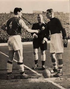 Stan Bartram made captain for the day in his last game for Charlton Athletic, 10th. March 1956. He shakes hands with Arsenal's Cliff Holton in a game in which Charlton won 2-0. Sam is leaving to become player-manager of York City