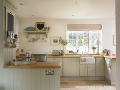 cupboards painted in Farrow and Ball Shaded White | a soft neutral tone with a touch of beigey green | Natural Calico