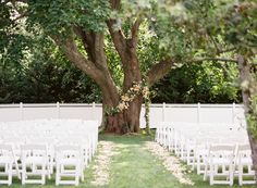 When adorned with gorgeous flowers, a grand tree in the backyard makes a romantic backdrop for your ceremony.