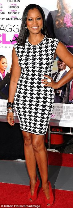 Leggy lady: Garcelle Beauvais showed off her figure in a fitted houndstooth frock as she posed on the red carpet