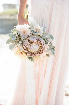 Protea Bouquet |  I love this.....Maybe this instead of the magnolia? If we go this route, maybe do a smaller version for the cake/?