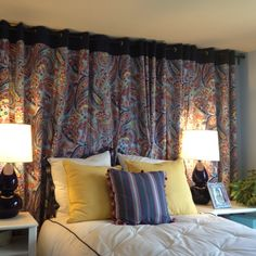 I love using the curtains to cover the whole wall and act as a headboard.