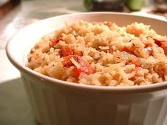 My mothers signature Spanish rice recipe, a delicious accompaniment to steak, chicken, and Mexican entrees such as tacos or enchiladas. Spanish rice is browned first with onions and garlic, then cooked in chicken stock with added tomato. yasminsmommy