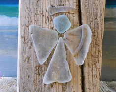 Sea glass Angel on driftwood. Find some cool driftwood and glue sea glass in the shape of an angel.