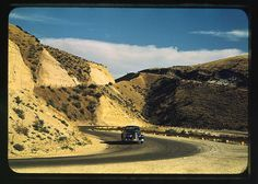 *Road cut into the barren hills which lead into Emmett. Emmett, Idaho, July 1941. Reproduction from color slide. Photo by Russell Lee. Prints and Photographs Division, Library of Congress