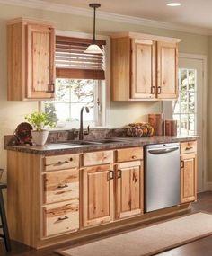 Hickory cabinets give your kitchen a warm, rustic look. Hickory cabinets are highly valued and opted for their resilience, beauty, prominent grains and strength. Menards Kitchen Cabinets, Hickory Kitchen Cabinets, Kitchen Cabinet Hardware, Kitchen Cabinet Design, Kitchen Cabinetry, Kitchen Redo, Kitchen Styling, Storage Cabinets, Kitchen Ideas