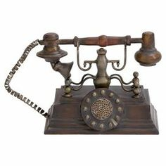 """Antique-inspired iron telephone decor.  Product: DecorConstruction Material: IronColor: Brown and goldDimensions: 7"""" H x 11"""" W x 5"""" D"""