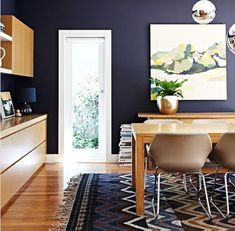 Midnight blue walls are a softer version of charcoal. Pretty with refreshing light wood and Missoni-inspired rug.