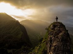 Taking a Peak Photograph by Liz Barney Picture of a hiker standing on the Ko'olau summit ridgeline in Hawaii