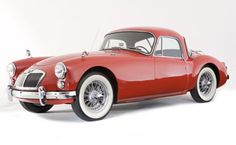 1958 MGA 1600 Coupe loved being dropped off by friend's Dad in this  except white & black
