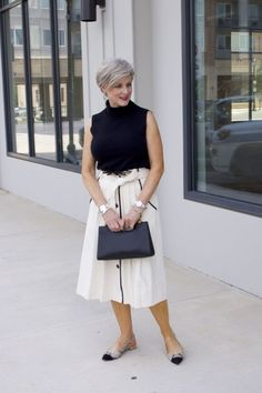 pleated cone denim skirt, black sleeveless turtleneck,
