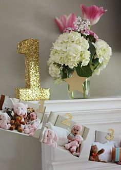 """Instead of big, multicolored """"1"""" balloons, incorporate fancy decorations in strategic places in your home. This sparkly number will have a classic spot on your mantel. 