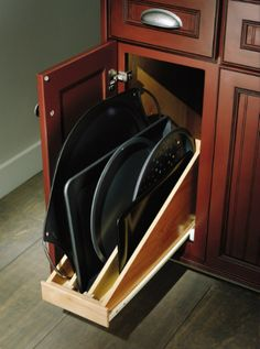 Roll out Tray Divider - one of my favorite kitchen cabinet accessories!  Makes great use of the space when you have to use a narrower cabinet!