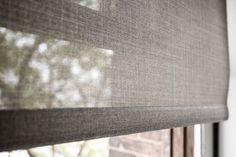 Close up of a light filtering roller shade. Privacy, light control and glare reduction.
