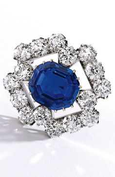 An Antique Silver-Topped Gold, Sapphire and Diamond Brooch, Austro-Hungarian, Last Quarter of the 19th Century. Centring an octagonal step-cut sapphire weighing 13.04 carats, framed by old European-cut diamonds weighing approximately 8.75 carats. #antique #brooch