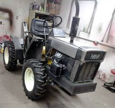 Just A Car Guy : Garden tractor based articulated 4 wheel drive hand crafted gardening machines! By Rock and Son Fabrication