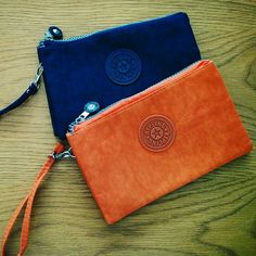 "BF SALE NWOT TWO KIPLING Pouch (SET) BIGGEST DISCOUNT EVER!!!  Offers last until 11.24.15ONLY  After that, price will be back to normal!  Grab it fast, ladies!!  * Get TWO of this adorable wristlet for just USD 27 * Navy & Orange * NWOT, never been used before * Top zip closure * Interior has back zip pocket and 2 open sections * 7.5"" x 4.5"" Kipling Bags Clutches & Wristlets"