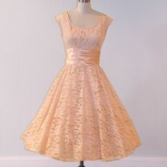 Ohhh!  A gorgeous peach lacy dress with a ruched peach satin waistband.  This is exactly my type of dress!! #1950s #party #dress