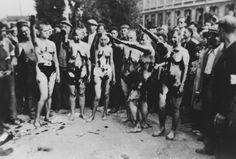 French women accused of collaborating with the Germans have their heads shaved by a mob, are stripped naked, covered in tar, and forced to give the Nazi salute for the camera. This was a common punishment for French, Belgian, and Dutch women who were...