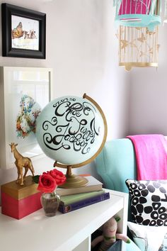 From @Kristin Jackson {the Hunted Interior}  Love this globe idea - would be a great graduation gift!