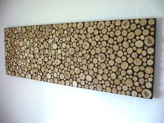 Would make a fun head board or, if I had months of boredom, a cool treatment for a focal wall.