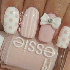 Cute pink and white nail art, not sure whether the bow is too much though