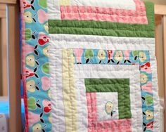 Pretty Pastels Log Cabin Baby Quilt...This free quilt pattern for babies can easily be customized for any little one you have in mind. Make it in pink for a little princess, blue for a brand new boy, or go neutral if the bundle of joy will be a surprise. ...we are going to make four Log cabin blocks- each measuring 20 by 20 inches.