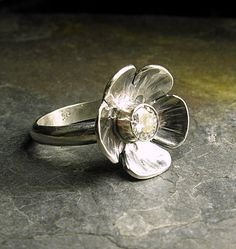Ice Flower - A gorgeous 5mm moissanite is set in a sterling silver flower.  Big sparkle to brighten any winter's day.    ....from LavenderCottage on Etsy    $229