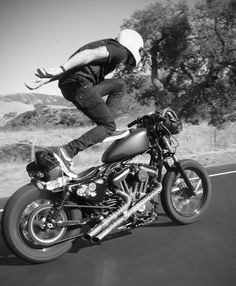 standing while riding on a motorcycle