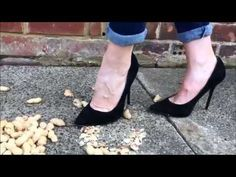 Crushing nuts under her suede stiletto heels - YouTube