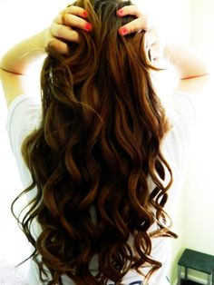 Perfect curls. I wish. This would last about five minutes in my hair.