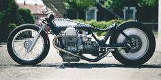 Meet Ferdinand the Sparrow: a slammed sprint bike built by Young Guns Speed Shop. Speed is its main mission, but there is infinite appeal in its gut-punch aesthetic. The 1200cc engine, transplanted from a 2007 Moto Guzzi Norge, is perched in a '76 Le Mans 1 frame. The frame and forks have been modified to help Ferdinand fly as low as possible—with the oil pan constantly flirting with a cracked pavement disaster.