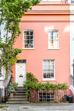 A peach house in Chelsea, London. Chelsea is known for its colorful houses and pretty side streets, and is a great place to explore in London. #chelsea #house #london