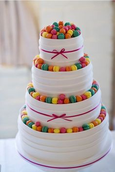 Wedding cake with mini macarons Or on a smaller scale with gumballs for a kids cake