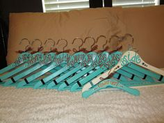 custom painted wood hangers for weddings, bridesmaids, teacher gifts, birthday gifts, college organizations, or any occasion. $12.00, via Etsy.