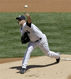 GAME 34: Sunday, May 13, 2012 - New York Yankees starting pitcher Andy Pettitte throws during the first inning of a baseball game against the Seattle Mariners at Yankee Stadium in New York. (AP Photo/Seth Wenig)