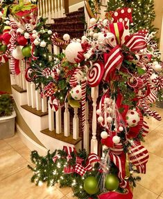 50 Best Candy Cane Christmas Decorations which are the Sweetest things you've Ever Seen - Hike n Dip Can't get enough of candy canes? Learn how to decorate your home for Christmas with these Candy Cane Christmas Decorations Ideas right here. Christmas Stairs Decorations, Diy Christmas Garland, Christmas Tree Themes, Christmas Holidays, Peppermint Christmas Decorations, White Christmas, Gingerbread Christmas Tree, Candy Cane Christmas Tree, Christmas Ideas