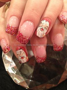 Gel overlays with red glitter tips and freehand Santa Christmas nail art