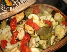 Vegetables in clay pot cooking.  Use squash, onions, eggplant, zucchini, tomatoes, bell peppers to make a tasty healthy vegetable bake./ Leave out oil!