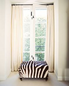 is the zebra white with black stripes or black with white stripes?  love this ottoman.