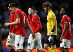 Manchester United trudge off the pitch at the Etihad Stadium after a despondent 1-0 loss to Manchester City. Match Report - http://www.ozmufc.com/2012/05/01/match-report-manchester-city-1-manchester-united-0/