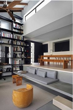 Creative shelving and different levels in a room make a living look exciting.