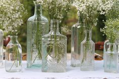 Vintage wedding inspiration - southernvintagegeorgia.com has a huge collection of antique bottles for rent to make your vintage wedding reception unique and lovely