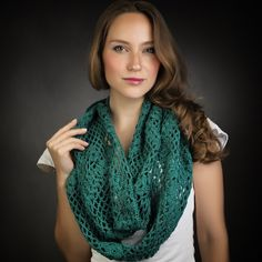The Freedom Collection in Emerald is a beautiful piece for year round wear! This soft cotton floral crochet pattern breathes in the heat but warms in the cold. It can be wrapped twice as pictured here, or three times for more warmth. Makes a great gift  this holiday season!!