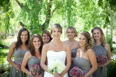 Grey and raspberry wedding, i like the different style of dresses,but all the same colour!